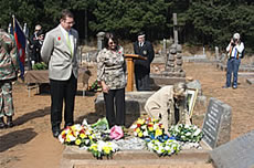 Evan Davies' granddaughter Colleen de Klerk laying a wreath on her grand father's grave attended by granddaughter Gilda Biassoni and great grandson Pierre de Klerk
